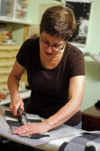 Joan at work creating a new handbag.